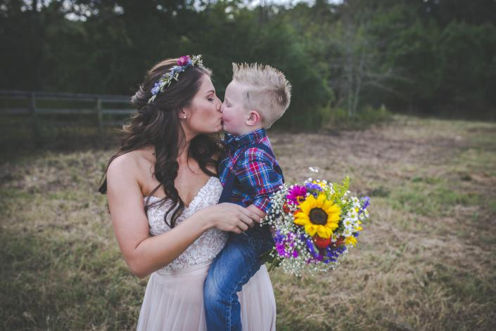Gorgeous bride and son displaying pure, unconditional love.